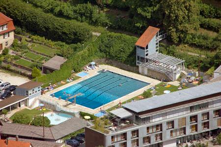 lido: Bird s view on a fairly empty public pool in Honau Germany Editorial
