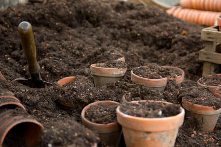 Clay pots filled with soil and a shovel Stock Photo - 16798489