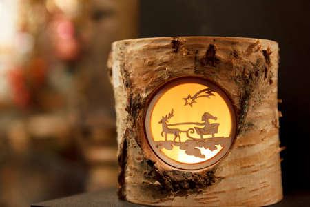 Little Santa and Reindeer scene in a birch stump Standard-Bild