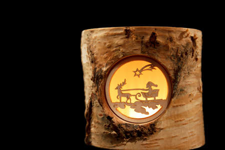 christkindlesmarkt: Little Santa and Reindeer scene in a birch stump  isolated
