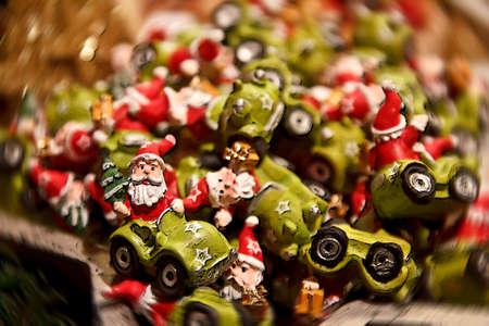 Santa riding his little green Race Car