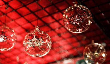 Christmas ornaments glas orbs in front of red background photo