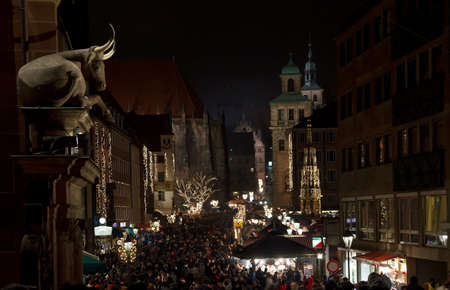 christkindlesmarkt: Ox guards the Way to Nuremberg Christmas Market at Night