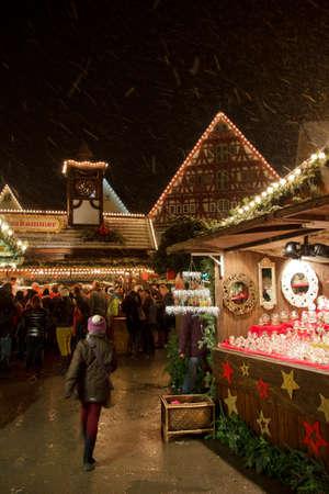 christmas market: An unidentifiable girl exploring Esslingen Christmas Market Editorial