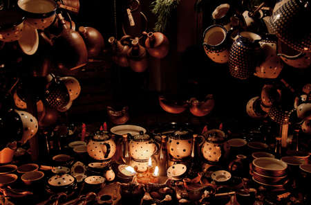 A frame of pots and jugs at the medieval market