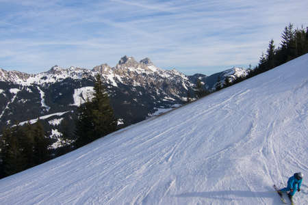 wintersport: Unidentifiable Skier on the slopes of Neunerkoepfle in the Austrian Tannheim Valley Stock Photo