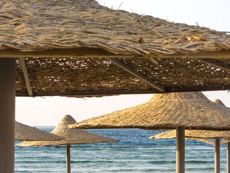bast: Bast Sunshades on a Beach in Egypt, obstruct the view on the Red Sea