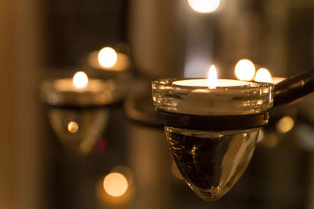 Closeup of candles in glasses on a candelabra, 1 Stock Photo