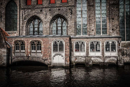Canal entrance to the 11th century Sint-Janshospitaal in medieval Bruges, Belgium, one of the oldest hospital buildings in Europe