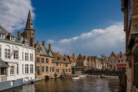 unrecognizable people: Rozenhoedkaai with tourist boats  unrecognizable people  in medieval Bruges, Belgium Editorial