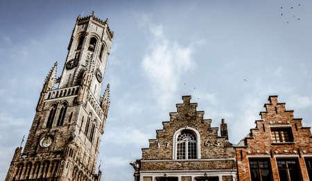 belfort: View on the Belfort of Bruges, next to medieval Corbie Step Buildings