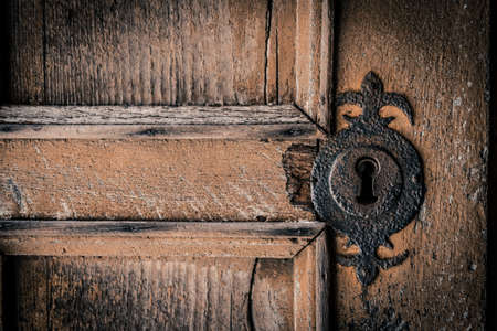 Closeup of the lock of an ancient door in a medieval castle photo