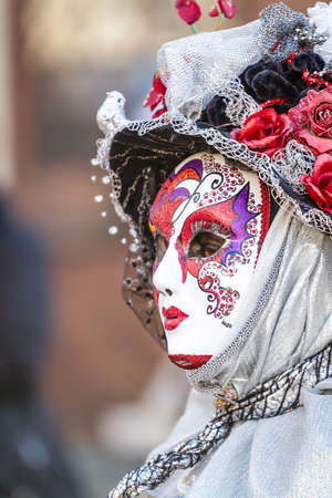 Schwaebisch-Hall, Germany - February 23, 2014 - Woman, dressed up in a Venetian style costume with a colorful mask attends the Hallia Venetia Carnival festival on February 23, 2014 in Schw�bisch-Hall