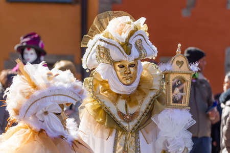 tricorne: Schwaebisch-Hall, Germany - February 23, 2014 - Man and a woman, dressed up in a Venetian style costume with golden masks attend the Hallia Venetia Carnival festival on February 23, 2014 in Schw�bisch-Hall