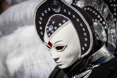 Schwaebisch-Hall, Germany - February 23, 2014 - Woman, dressed up in a Venetian style costume with an alien-like face mask attends the Hallia Venetia Carnival festival on February 23, 2014 in Schw�bisch-Hall