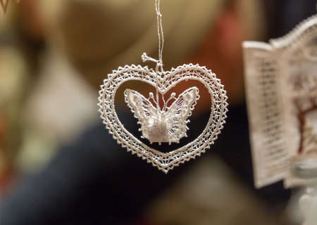 christkindlesmarkt: Lace Christmas ornament, shaped like a butterfly within a heart