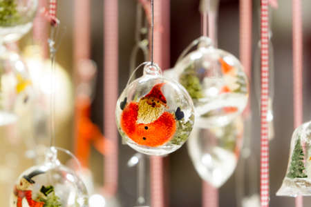 christmas market: Snowman glass ornaments hanging from a stall at Colmar Christmas market