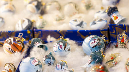 Different Christmas ornaments depicting snowmen on sale at a stall at the Christmas market photo