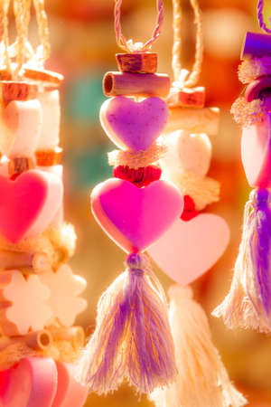 Kitschy colorful heart ornaments as a symbol for love photo