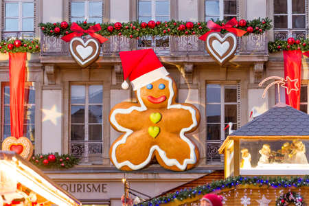 Giant gingerbread man decoration attached to a facade on a public building in Strasbourg, France photo