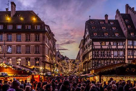 Strasbourg, France - December 8, 2013 - Crowds walk up Rue Merciere to the Christmas Market at dusk on December 8, 2013 in Strasbourg. Editorial