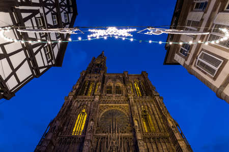Night view of Strasbourgs impressive Cathedral during Christmas Season photo