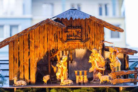 Nativity scene made of wood at a Christmas market photo