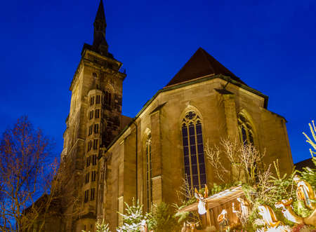 The main Stuttgart medieval parish church Stiftskirche inside the Christmas market during blue hour photo