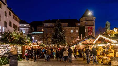 Stuttgart, Germany - December 21, 2013 - People stroll over the Christmas Market opposite the Old Palace (Altes Schloss) at night on December 21, 2013 in Stuttgart.