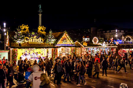 Stuttgart, Germany - December 21, 2013 - People shop for Christmas candy on the Christmas Market on Schlossplatz (Palace Square) on December 21, 2013 in Stuttgart.