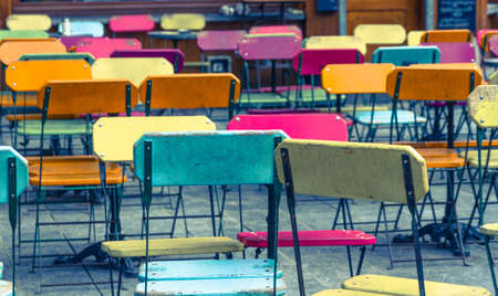 Colorful folding chairs at an empty sidewalk cafe in Brussels, Bruxelles-Capitale, Belgium photo