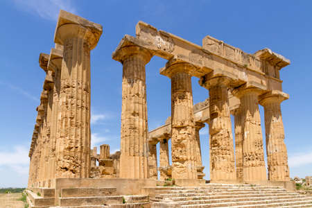 crumbling: Ruin of Temple E  (Temple of Castor and Pollux) in the archeological park of Selinunte in southern Sicily