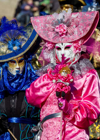 carnevale: Schwaebisch-Hall, Germany - February 23, 2014 - Person, dressed up in a pink Venetian style costume attends the Hallia Venetia Carnival festival on February 23, 2014 in Schw?bisch-Hall.
