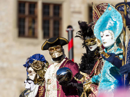 Schwaebisch-Hall, Germany - February 23, 2014 - People, dressed up in Venetian style costumes attend the Hallia Venetia Carnival festival on February 23, 2014 in Schw?bisch-Hall.
