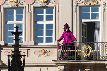Schwaebisch-Hall, Germany - February 23, 2014 - Person, dressed up in a Venetian style costume greets from a balcony at the Hallia Venetia Carnival festival on February 23, 2014 in Schw?bisch-Hall.