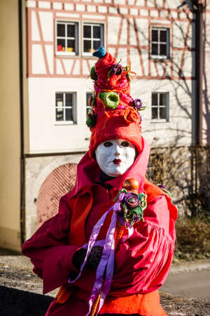 Schwaebisch-Hall, Germany - February 23, 2014 - Person, dressed up in a Venetian style Joker costume attends the Hallia Venetia Carnival festival on February 23, 2014 in Schw?bisch-Hall.