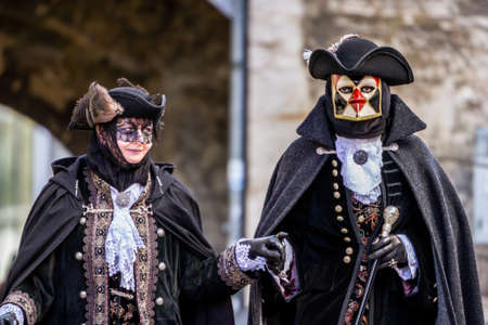 tricorne: Schwaebisch-Hall, Germany - February 23, 2014 - Man and a woman, dressed up in Venetian style costumes attend the Hallia Venetia Carnival festival on February 23, 2014 in Schw?bisch-Hall.