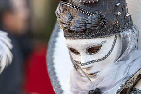 Schwaebisch-Hall, Germany - February 23, 2014 - Woman, dressed up in a Venetian style costume with a white mask attends the Hallia Venetia Carnival festival on February 23, 2014 in Schw?bisch-Hall.
