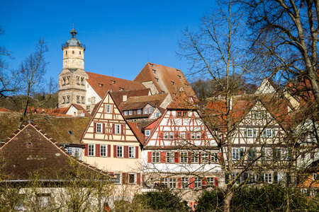 Panorama of the timbered houses and romanesque church of a medieval German town.
