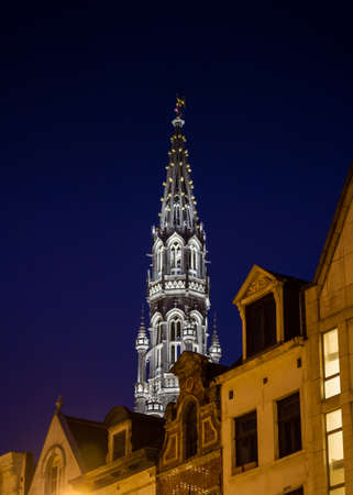 Illuminated tower of the gothic city hall of Brussels at night