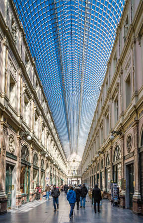 Brussels, Belgium - April 1, 2013: People shop in the historical Galeries Royales Saint-Hubert shopping arcades in Brussels on April 1, 2013.