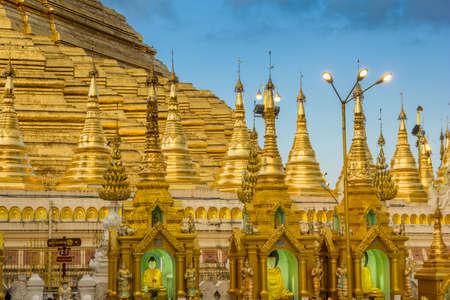 Golden Buddha shrines at the Shwedagon Pagoda in Yangon, MyanmarBurma