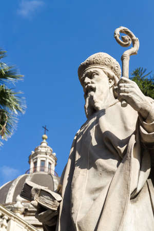 Closeup of a baroque statue of a bishop, located in front of the cathedral of Catania in Sicily Standard-Bild