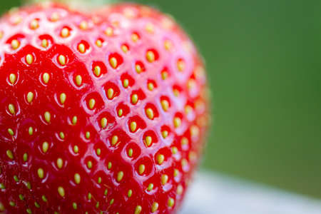 Extreme closeup of a strawberry with very low depth of field
