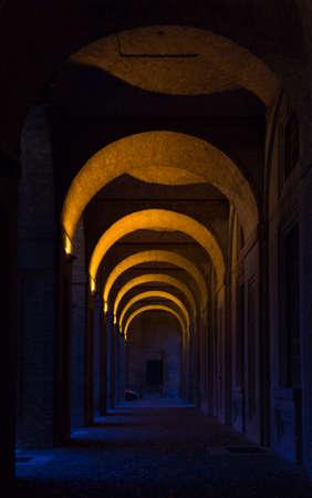 The arcade of 16th century Palazzo della Pilotta in Parma, Italy at night