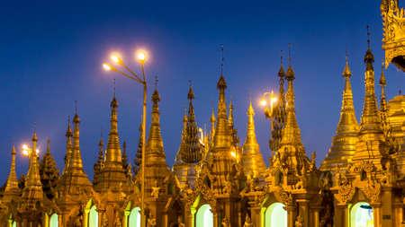 Many golden shrines at Rangoon's famous Shwedagon Pagoda during blue hour