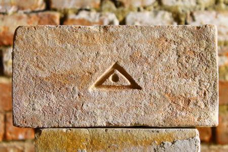 The eye of Providence on old brick photo