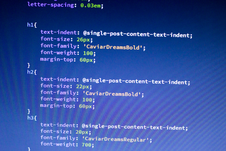 Web development code: CSS / LESS styles preprocessor script lines. Abstract screen of web developer.