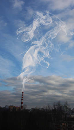Chimney smokestack Pollution in the air on the blue sky