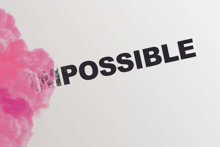 Word Impossible turning into Possible with pink smoke. Startup business motivation concept.